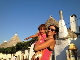 Mother and Daughter - Tourists in Alberobello with Trulli Houses
