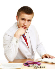 A male doctor working at desk