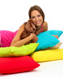 beautiful young girl and fluffy bear with pillows isolated