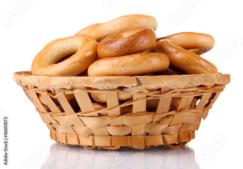 tasty bagels in basket, isolated on white