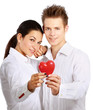 Couple holding a red heart, isolated on white background