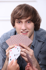 Teenage boy playing cards