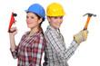 Tradeswomen holding tools