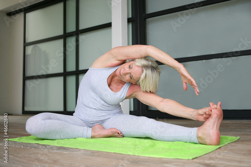 Senior woman practicing yoga