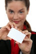 Businesswoman displaying business card