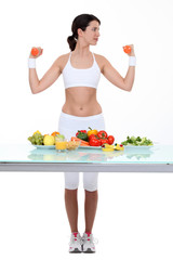 Woman with dumbbells and healthy food