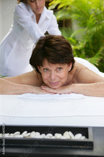 Woman receiving a massage at a day spa