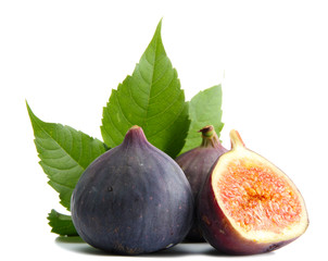 Ripe sweet figs with leaves isolated on white