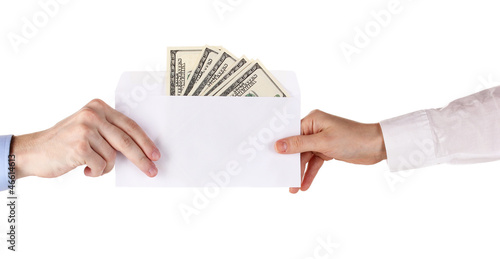 woman's hand passes the envelope with dollars