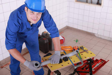 young plumber with miscellaneous tools