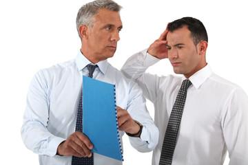 Businessman reprimanding his employee