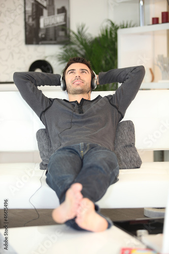 Man relaxing on a sofa