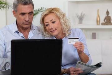 senior couple shopping on the Internet