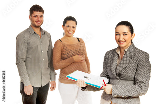 Happy couple and real estate agent