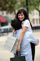 Couple hugging during shopping trip