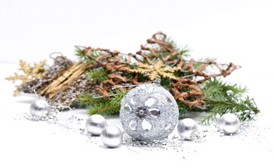 Silver xmas decoration with green branch