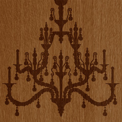 luxury chandelier silhouette on the wooden background