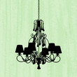 silhouette of luxury chandelier on a scratched green wallpaper