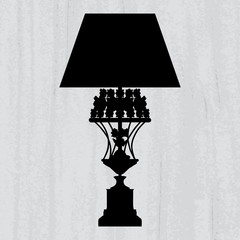 silhouette of luxury lamp on a scratched grey wallpaper/ templat