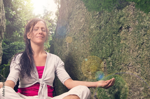 Yoga between Rocks with Lensflares