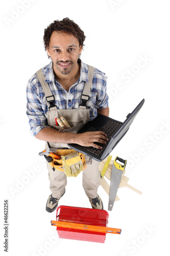 Carpenter posing with a laptop