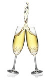 Pair of flutes making an elegant splash of champagne.