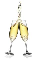 Pair of flutes making an elegant splash of champagne.