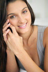 Close-up of brunette making telephone call