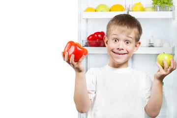 cute boy near the open refrigerator