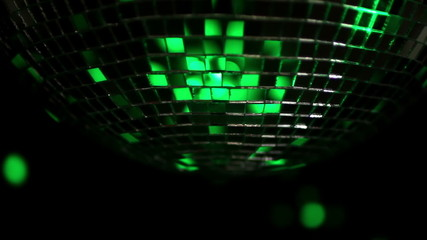 abstract funky discoball spinning with light effects and rays