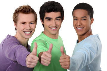 A group of young men giving the thumb's up