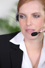 Receptionist with headphones and microphone