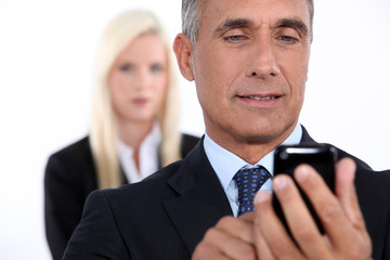 Closeup of a senior businessman using mobile phone