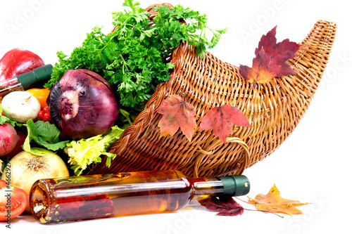 Autumn cornucopia, olive oli and different group of vegetables