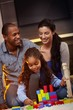 Interracial family at home playing smiling