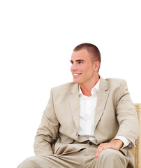 Young manager sitting on chair in office