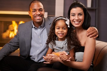 Portrait of beautiful mixed race family at home