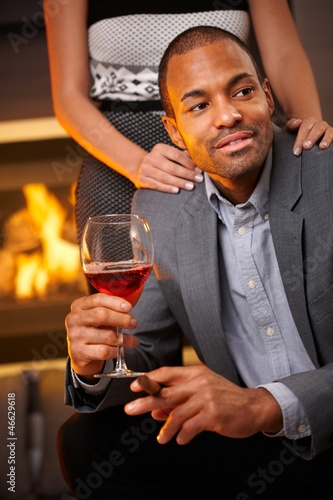 Goodlooking man with cigar and glass of wine