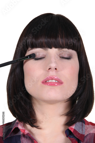 Woman making up her eyes