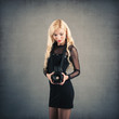 Beautiful young woman with medium format camera