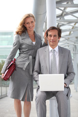 Executives with laptop computer