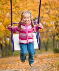 little cute girl swinging