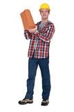 Tradesman holding terracotta shingles poster