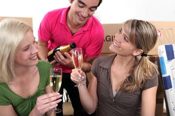 House-mates celebrating move