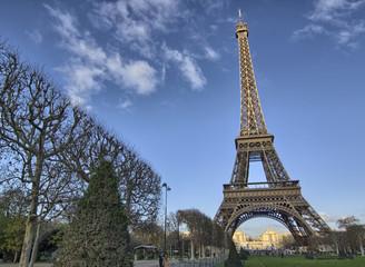 Eiffel Tower and Champ de Mars in Paris, France. Famous landmark