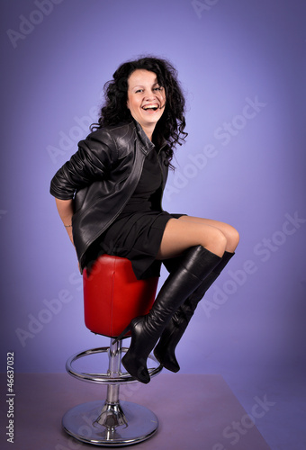 Brunette woman  on the chair