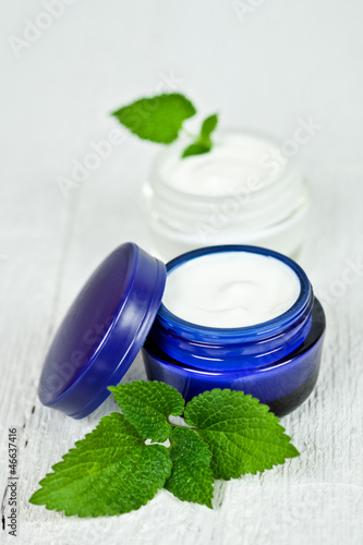 face cream in jars with urtica leaves