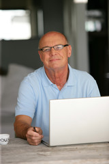Bald man working from home