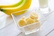 Fresh banana in the glass bowl, banana and milk