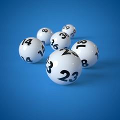 Lottokugeln auf blauem Hintergrund